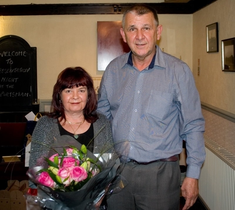 Belle Landlady of the Sportsman Inn receiving flowers from Bob McKie
