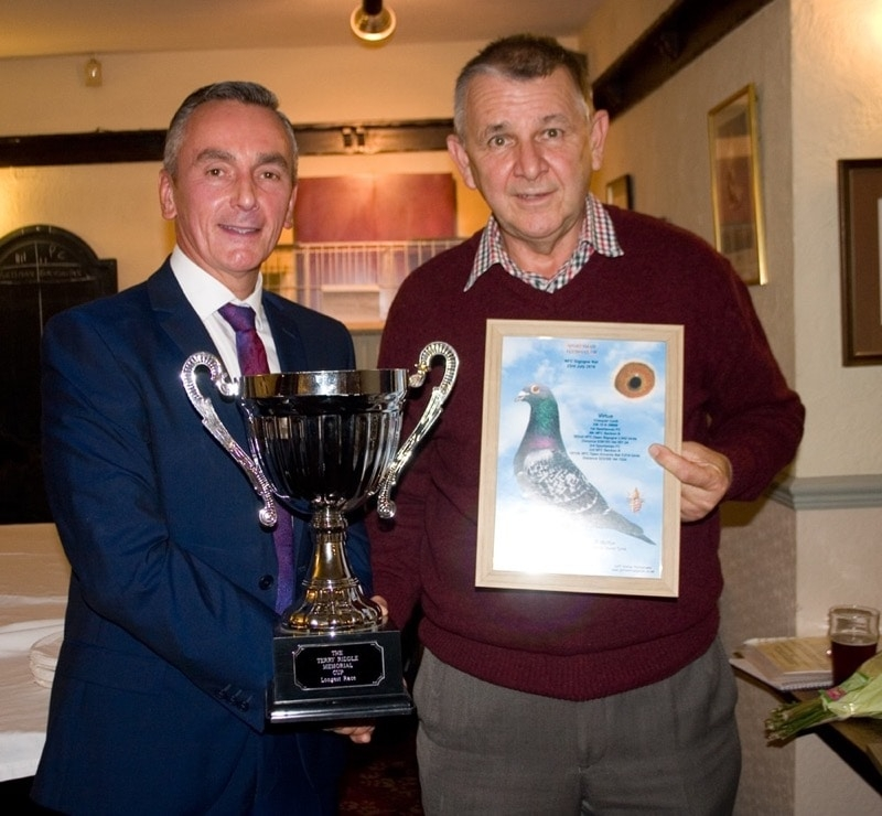 Bob McKie of Blackhall Mill was R_U for the Sportsman FC averages - Bob receiving the Tom Riddle Memorial trophy from Barrie Winter for winning the Sigogne race