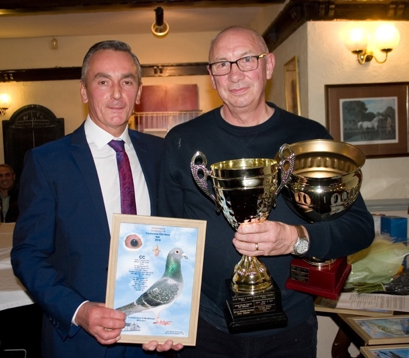 Barry Winter presenting Tom Cuthbertson with their trophies - Cuthbertson & McWilliam of Willington winners of the Coutances Old Hens race