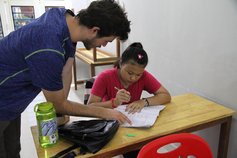 aussie-helping-a-cambodian